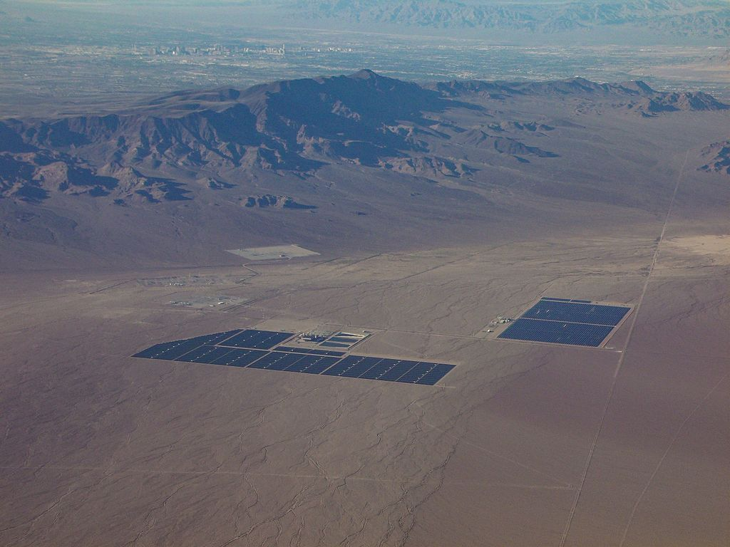 Lead image: A photograph of Nevada Solar One (right), and Copper Mountain Solar 1 (left): taken from a commercial jetliner in Fall 2011. Credit: Michael Adams.