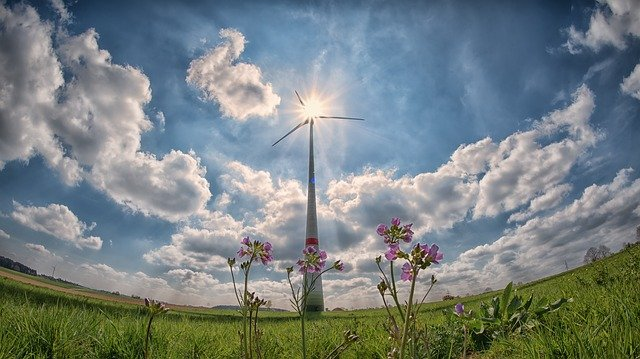 Wind Turbine with Sun and Clouds Panoramic