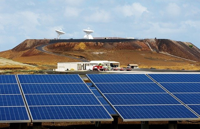 Solar Panels with Hills in Background