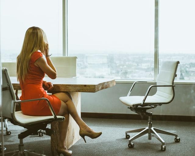 Business Women Looking Out Window